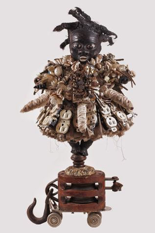Girl on a Skate on a Pulley; Figure to Speak for the Abundance of the Soul, 2011 Wood, plaster, wood glue, water, paint, hair, nails, buttons, shells, old skate, pulley, prayer beads, 20 x 12 x 10 inches