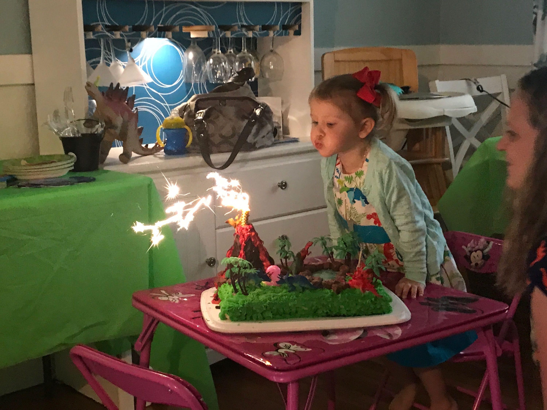 Dinosaur cake with sparkler volcano cake sparklers