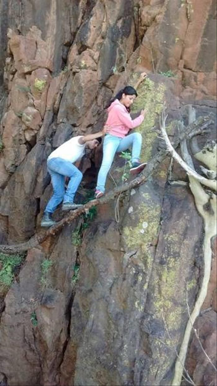 Not sure if he's trying to help her or holding on for dear life?!
