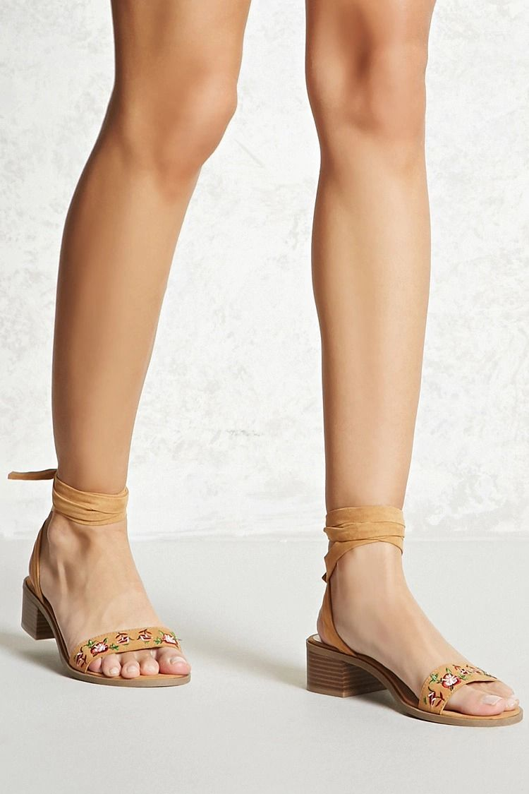 c0f50345244 A pair of faux suede sandals featuring an embroidered open toe vamp strap