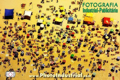 Aerial photo of Ipanema beach with people lay down on sand, sun bath, Rio de Janeiro, Brazil. Annual report photo. Click to visit Photoindustrial site goo.gl/6W7zNS  Foto aérea sobre a praia de Ipanema com pessoas deitadas na areia.  Foto para relató Check out this also: http://www.revstarglobal.com/simonedvin