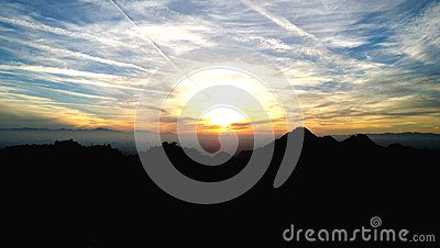 Contrasting Mountain With Orange Yellow And Blue Sunset