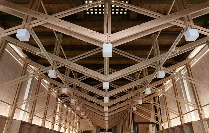 inverted trusses inserted inside historic dry-goods store ...