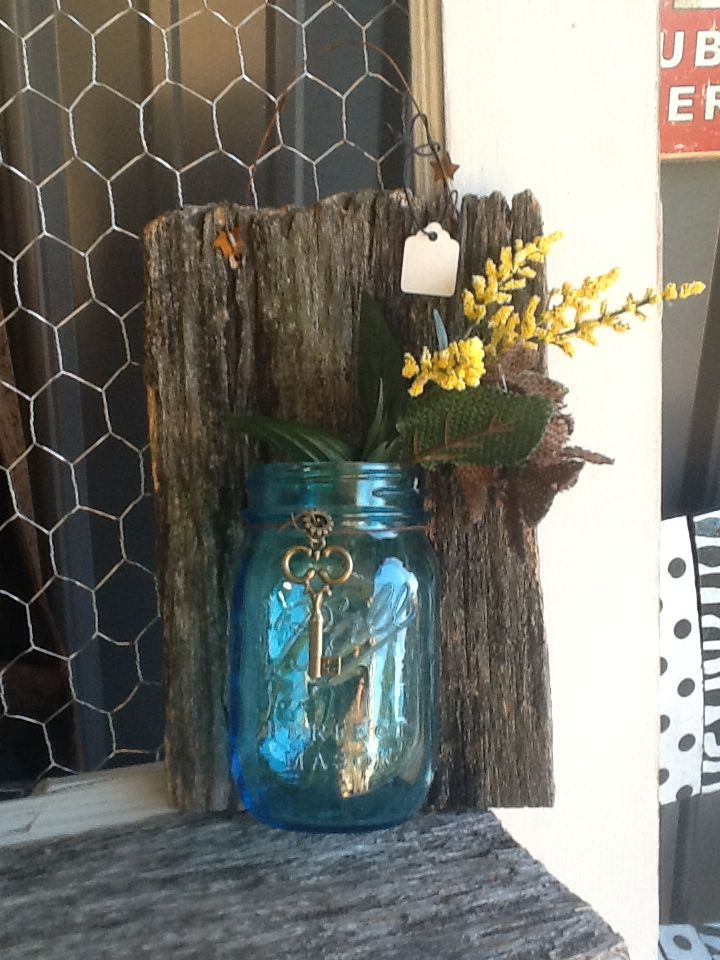 Ball jar wired to old barn wood with vintage key.
