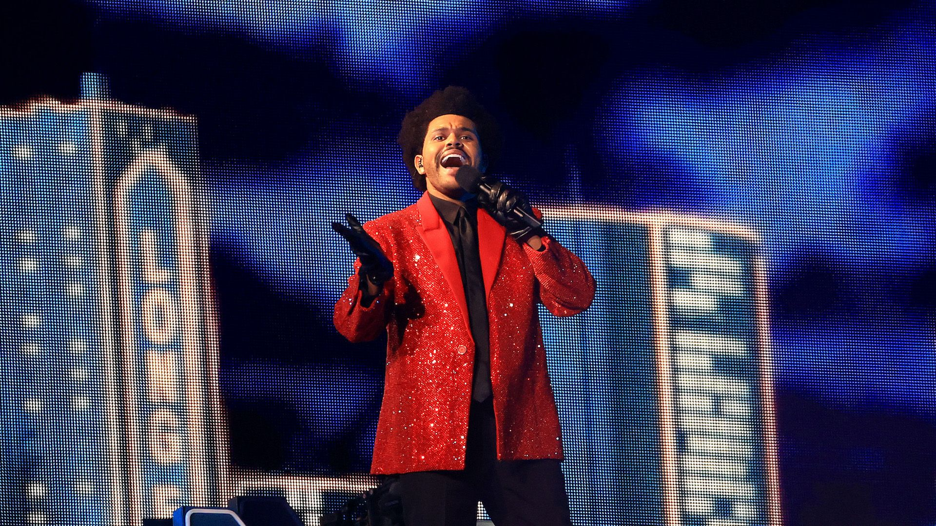 People Are Raving About The Weeknd S Futuristic Super Bowl Lv Halftime Show In 2021 Halftime Show Super Bowl Red Jacket