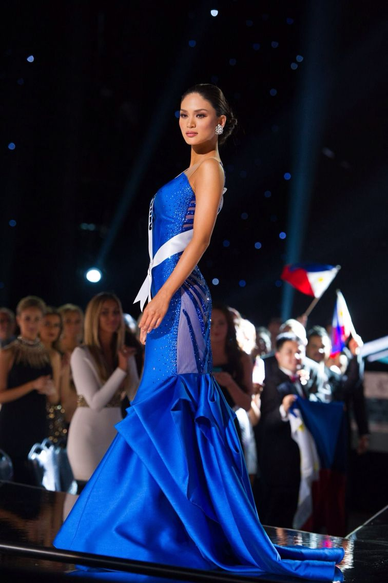 Royal blue gown made by Filipino designer Albert Andrada, the ...