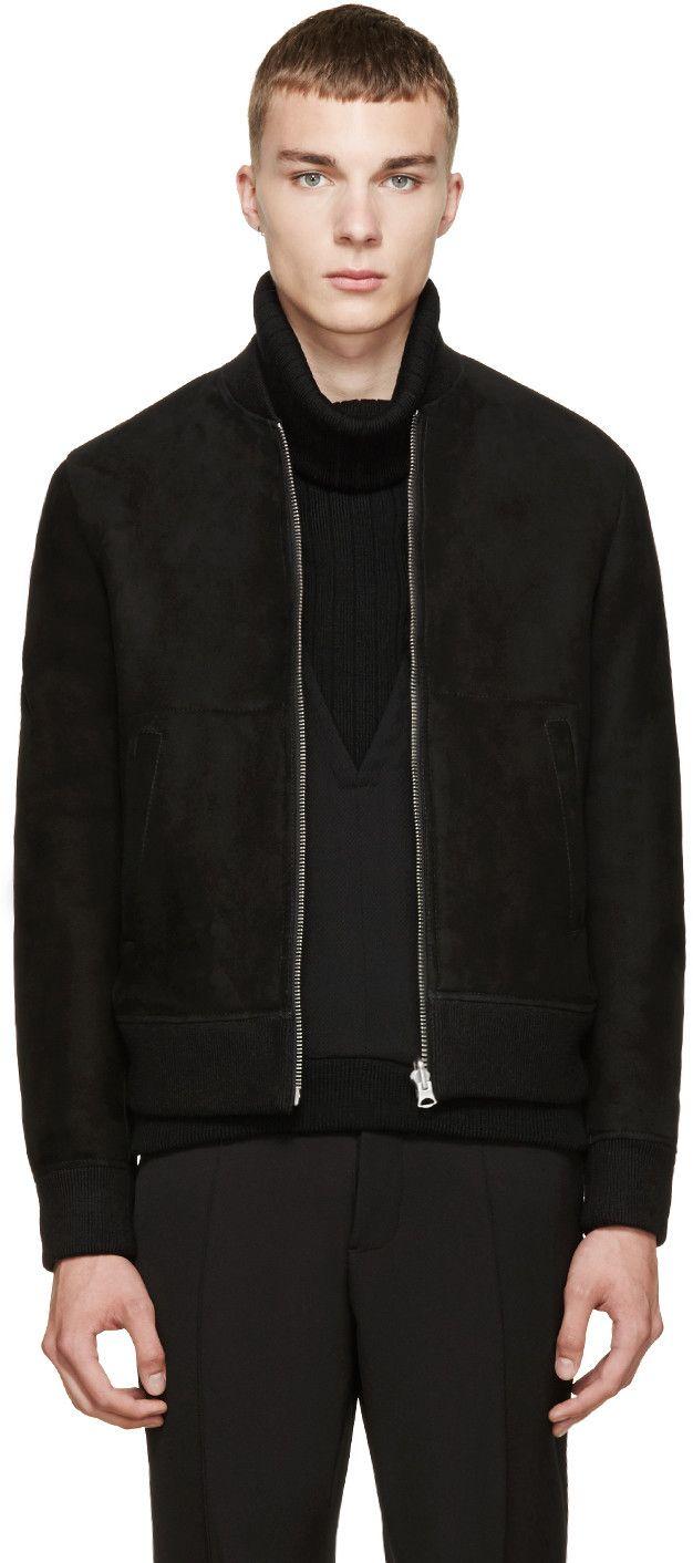 Shearling bomber jacket in black. Ribbed stand collar, cuffs and hem. Zipper closure at front. Welt pockets at waist. Short wool lining. Welt pockets at interior. Tonal stitching.
