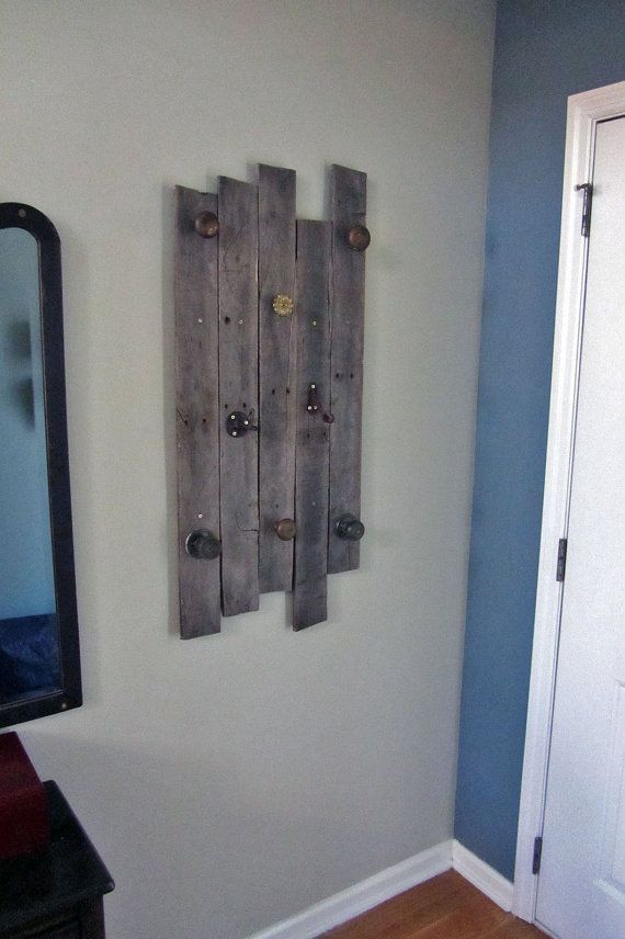 Custom made wood coat and accessories rack made from reclaimed wood and salvaged brass hardware.