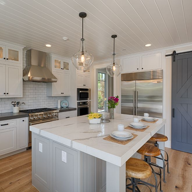 Mindful Gray Kitchen: Perimeter Cabinets: Alabaster; Island: Mindful Gray SW 7016; Pantry Barn Door: Peppercorn SW7674