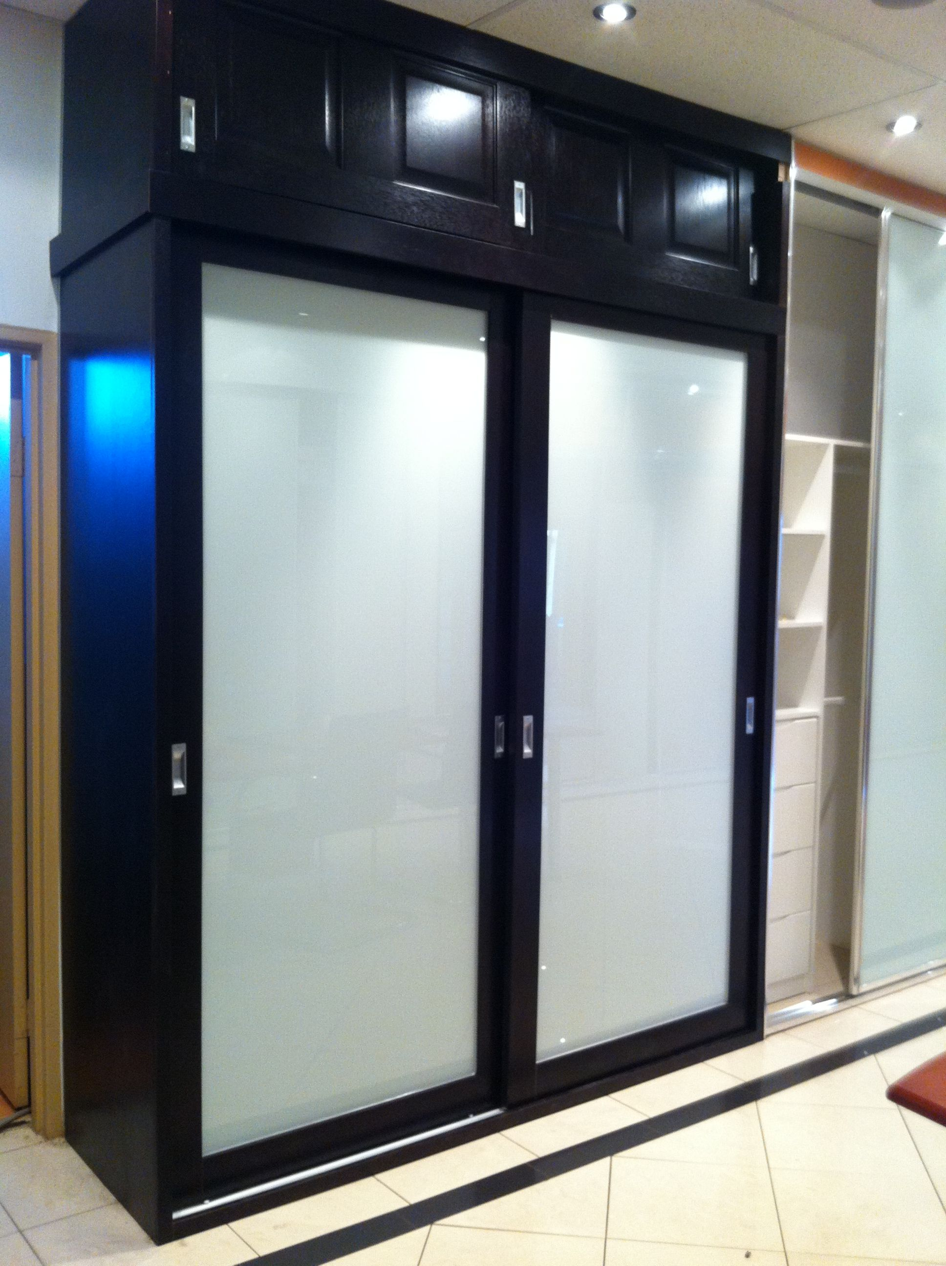 Fashionable white frosted glass doors with black and white - Bedroom cabinets with sliding doors ...