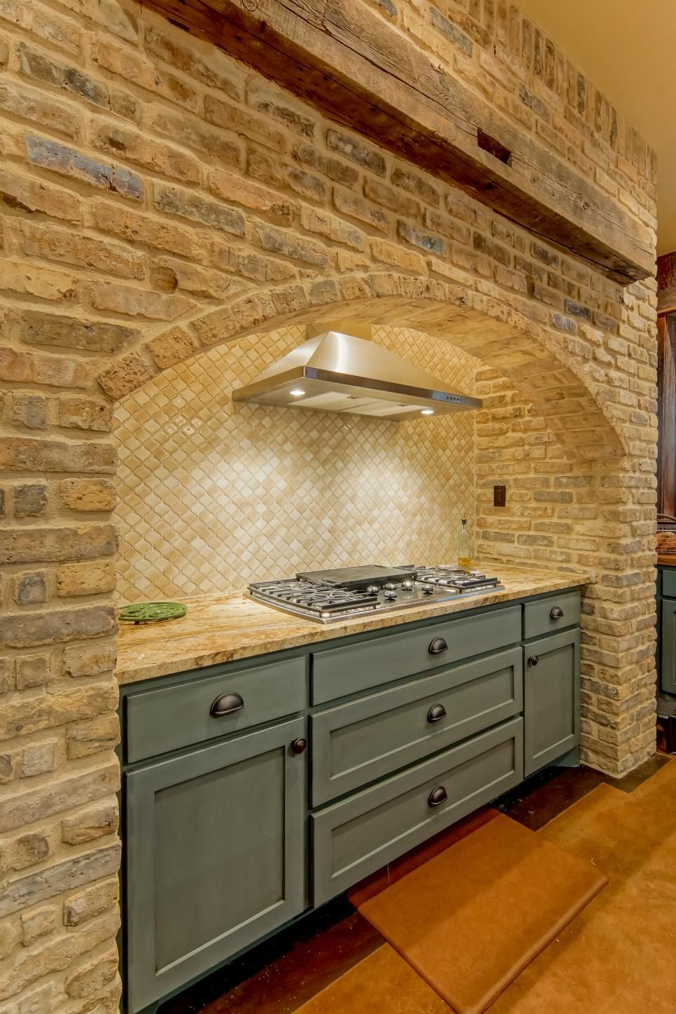 country kitchen range hoods sink installation cost a beautiful brick surround frames this stove area with an ...