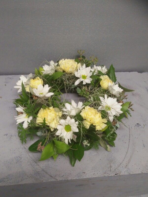 Week Five: Centrepiece or wreath: Ming fern, fejoa, holly, scented geranium, ruscus and old mans beard foliage. Daisy carnations and crystanthumums.
