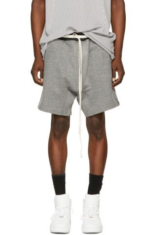 9b75249744 Relaxed-fit French terry lounge shorts in heather grey. Drawstring at  striped rib knit waistband striped in black and white. Four-pocket styling.