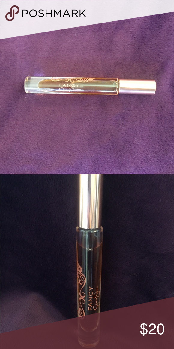 Used Jessica Simpson Fancy Rollerball .2 oz Used Jessica Simpson Fancy Rollerball .2 oz. now discontinued. I had this for awhile & maybe used it 3-4 times, there is little settlement from sitting in my drawer all this time but still smells like before. Jessica Simpson Makeup
