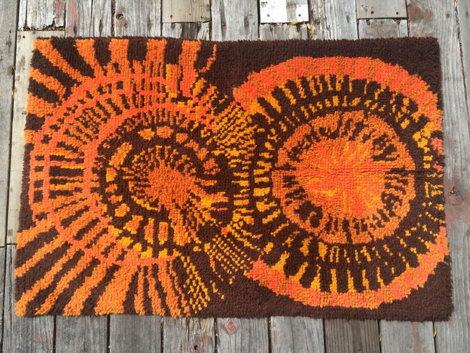 A personal favorite from my Etsy shop https://www.etsy.com/listing/277727470/vintage-1960s-rya-rug-rusty-orange-gold