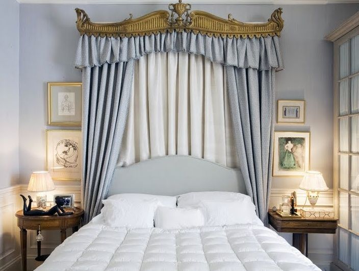 Powder blue, white and antique gold drapery headboard and bed