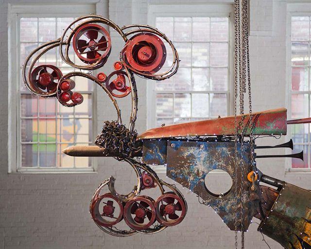 Xu Bing Arrives at Mass MoCA With His 12 Ton Birds Made of Construction Equipment sculpture light construction birds assemblage