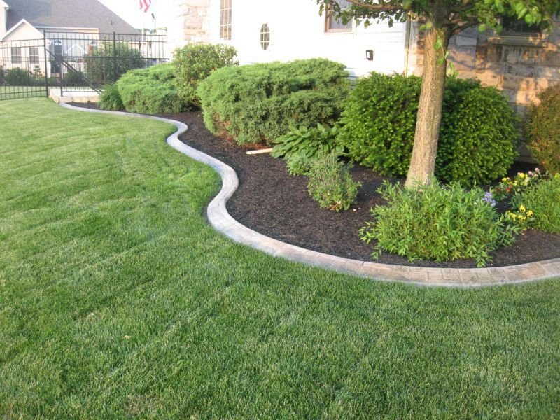 Decorative landscape curbing in mechanicsburg pa red for Decorative boulders for yard