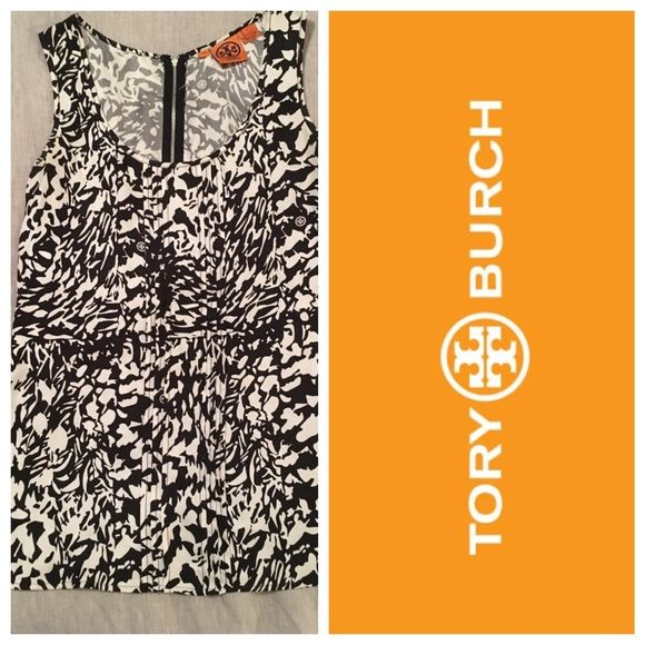 Tory butch silk sleeveless blouse Tory butch silk sleeveless blouse, black and white print with small pleats down the front middle. Great used condition. Size 2. Has a zipper at the back top. Tory Burch Tops Blouses