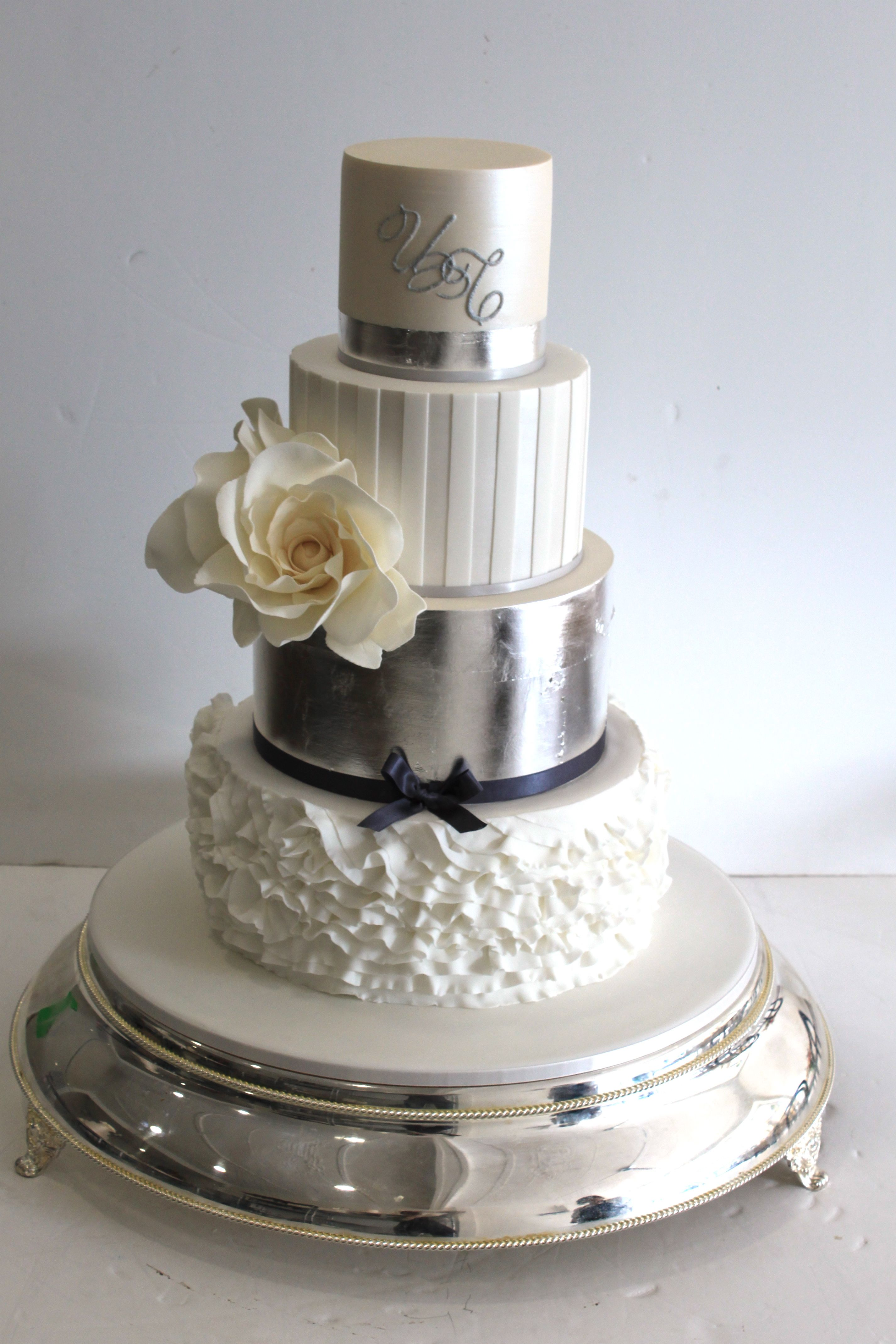 White and Luster Fondant Tiers with Gumpaste Flowers. --Faye Cahill ...