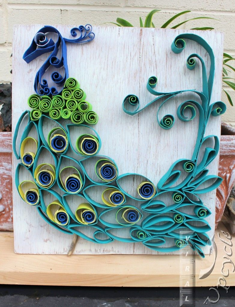 Paper towel roll art into a rustic bohemian peacock by viral upcycle