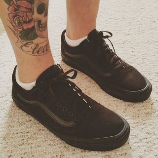 all black old skool vans on feet