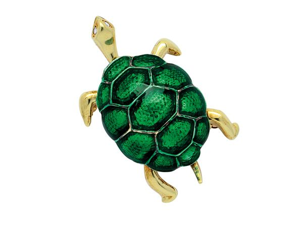 Designed as a turtle with green enamel shell and tiny round diamond eyes, mounted in 14k gold, length 1 1/4 ins