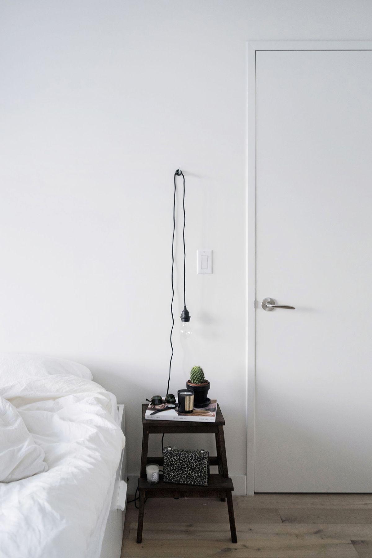 Ikea Bekvam stool side table DIY + hanging lightbulb   Scandinavian, industrial bedroom in New York City
