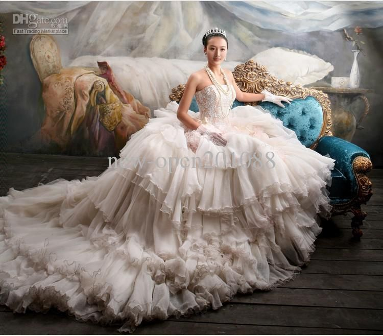 New super luxury fluffy wedding dress strapless chapel for Fluffy skirt under wedding dress