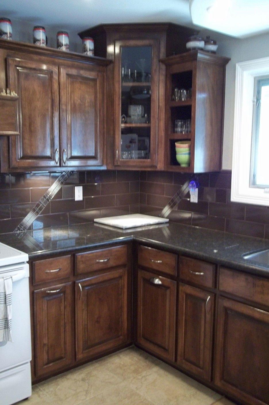 Image result for black granite brown cabinets | Dark wood ...