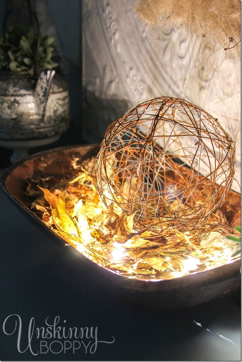 lighted fall leaves in a dough bowl with a rusty wire ball     lighted fall leaves in a dough bowl with a rusty wire ball