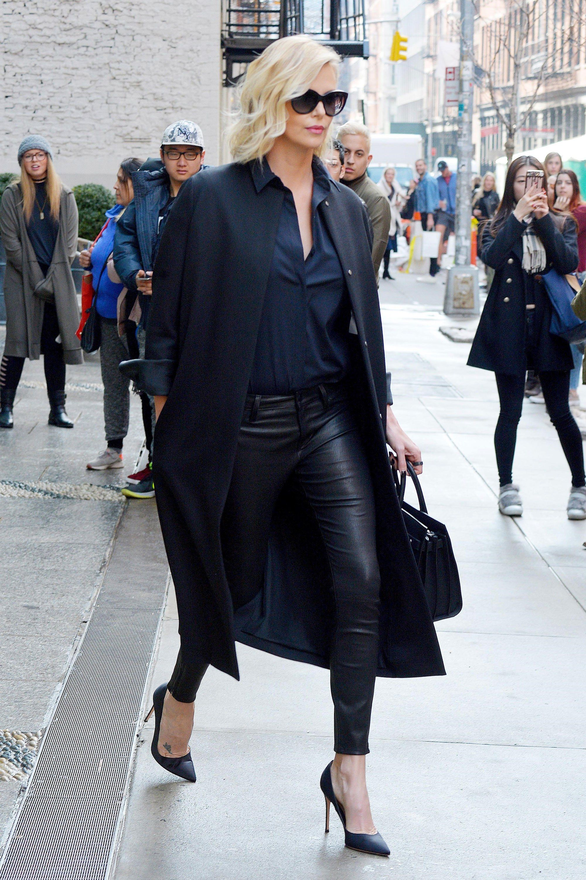 0ec00044df0d Charlize Theron Is Giving Kendall Jenner a Run for Her Money in These  Leather Pants - February 2017
