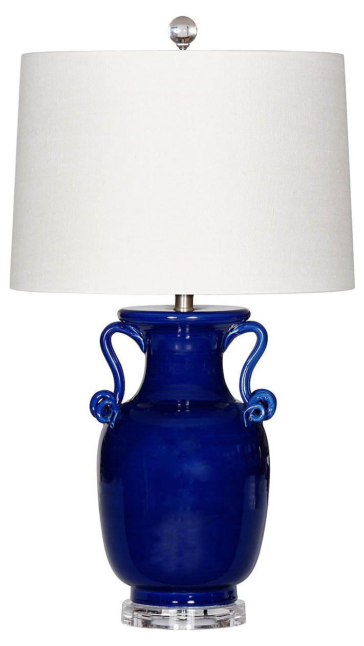 This hand-thrown Italian ceramic jar lamp is glazed in a deep navy and finished with a crystal finial. The hardback drum shade is made of fine cream linen burlap. Made in Italy.