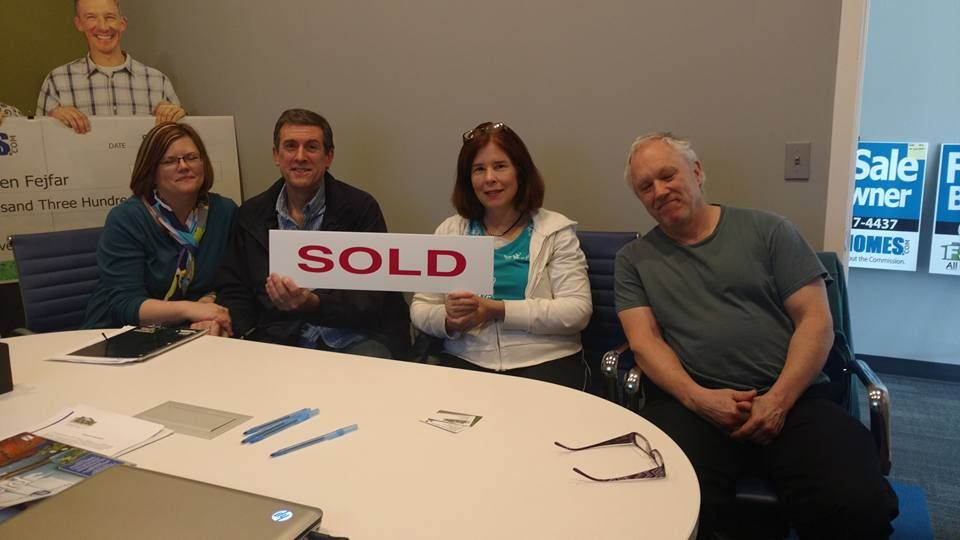 Buyers and Sellers meeting in the conference room with the - home purchase agreement