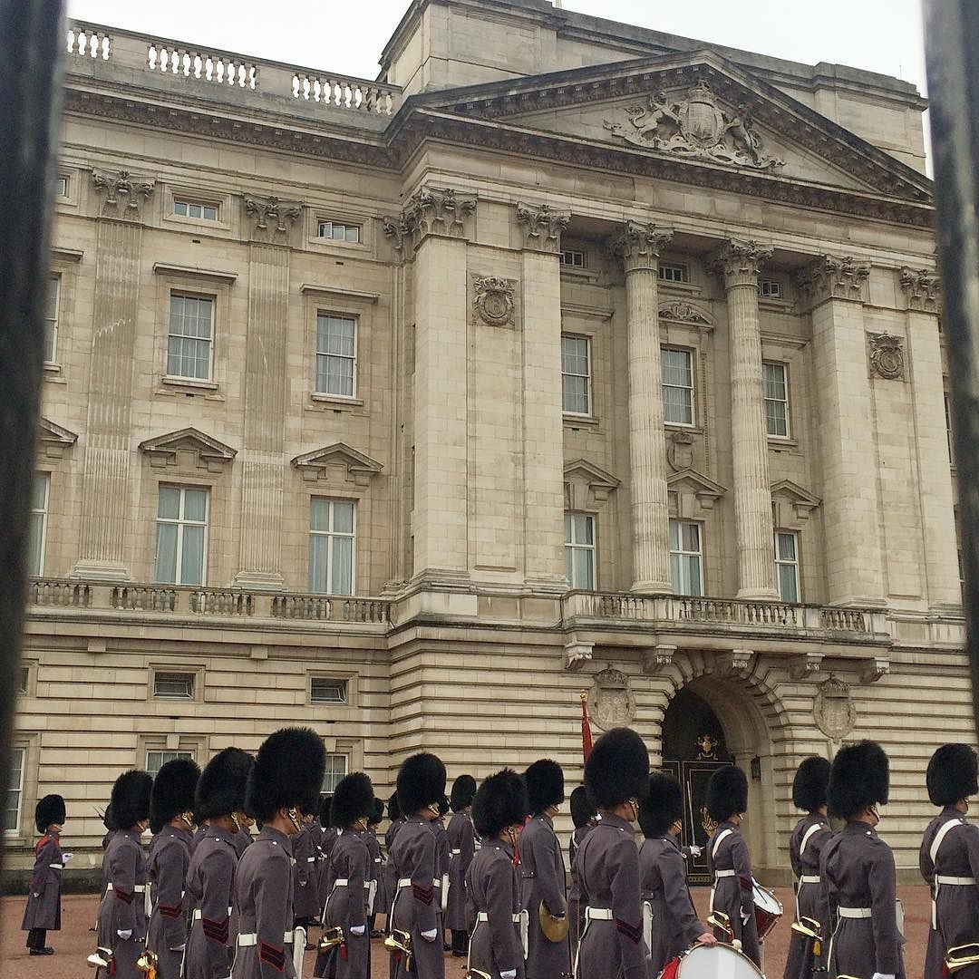 Changing of the Guard - can't see the flag but the Queen was in this morning #ScotsGuards #BuckinghamPalace #QueensGuard  by erincarcel
