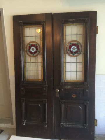 Old antique two wooden church doors with leaded glass ...