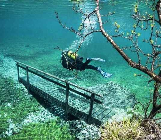 Grüner See (Austria) - The Grüner See is a green lake with crystal clear water coming from the mountains. In spring this lakes gets filled to the brim,  although for the rest of the year it is a park. Dive in spring to benches, trees and fountains. Discover more unique travel inspiration on www.mapiac.com !