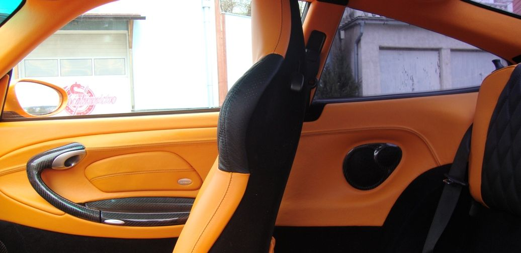 Porsche orange and black interior 3