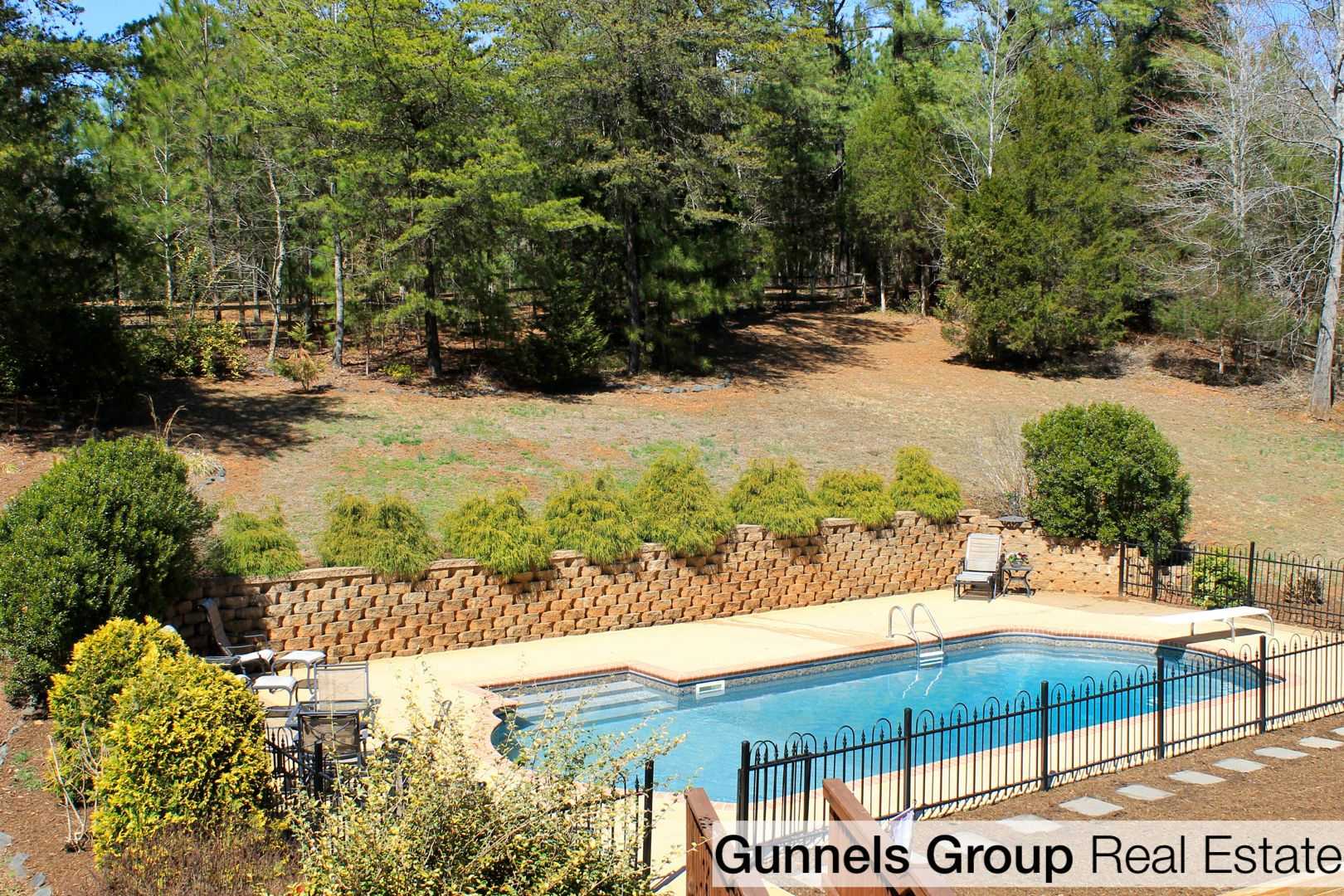 Summer Fun! Dive in this gorgeous 34x16 in-ground pool, accented by ...