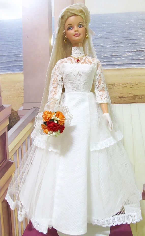Barbie doll is in good condition, all her parts work well, and her hair is long shiny. Her two piece wedding outfit also in good condition, from 1960s. She comes with vintage long petticoat, vintage shoes, golden necklace and Mimis Haute Couture flower bouquet. Doll and outfit are clean and FOOO. Smoke Free Environment
