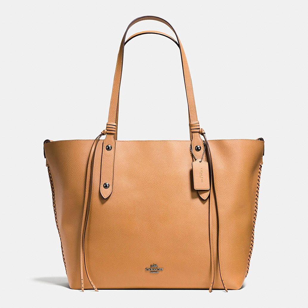 84fca725a3 Shop The COACH Large Market Tote In Polished Pebble Leather With Whiplash  Detail. Enjoy Complimentary Shipping   Returns! Find Designer Bags