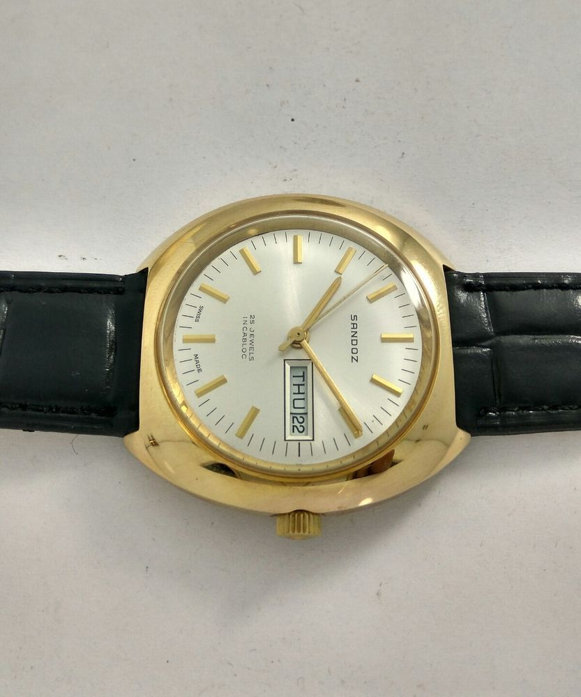 For lovely vintage sandoz watch