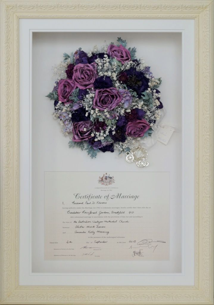 A stunning mixed purple bouquet of roses, lisianthus, tulips ...