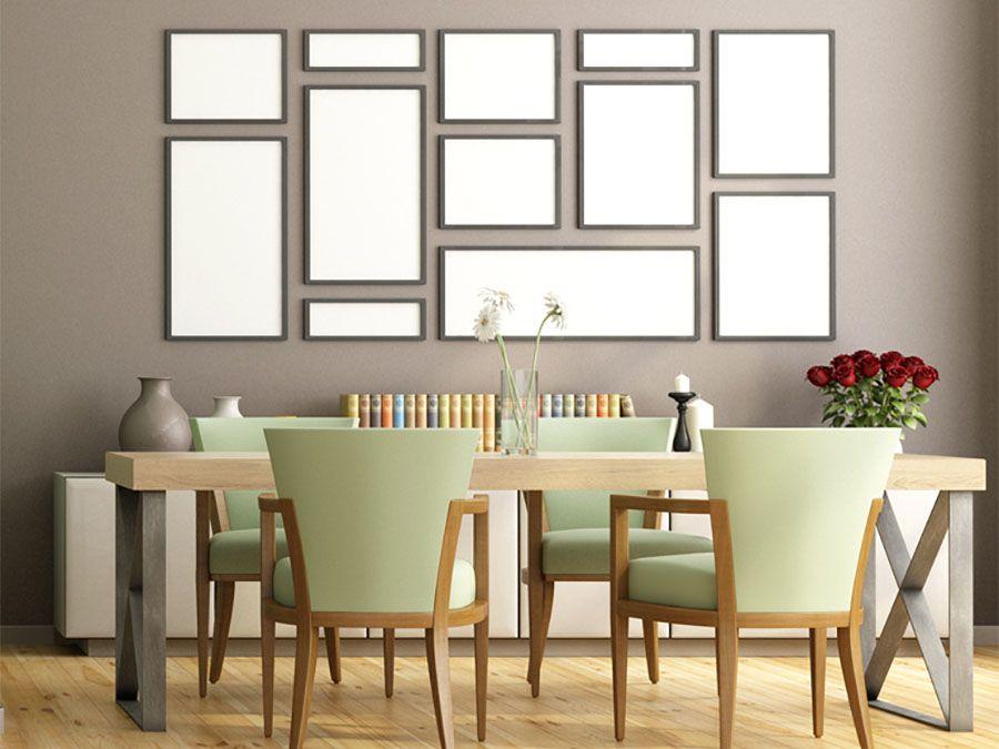 Esempio di disposizione geometrica di quadri in soggiorno idee