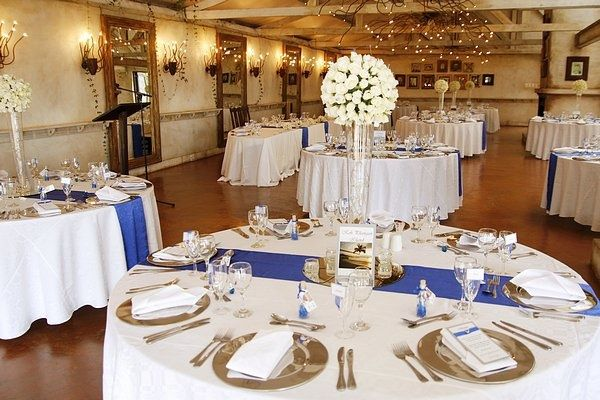 White Tablecloth With Royal Blue Table Runners Not The Centerpieces