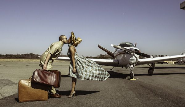 Airport and Yacht Themed Engagement Session with Nigerian Cultural Elements