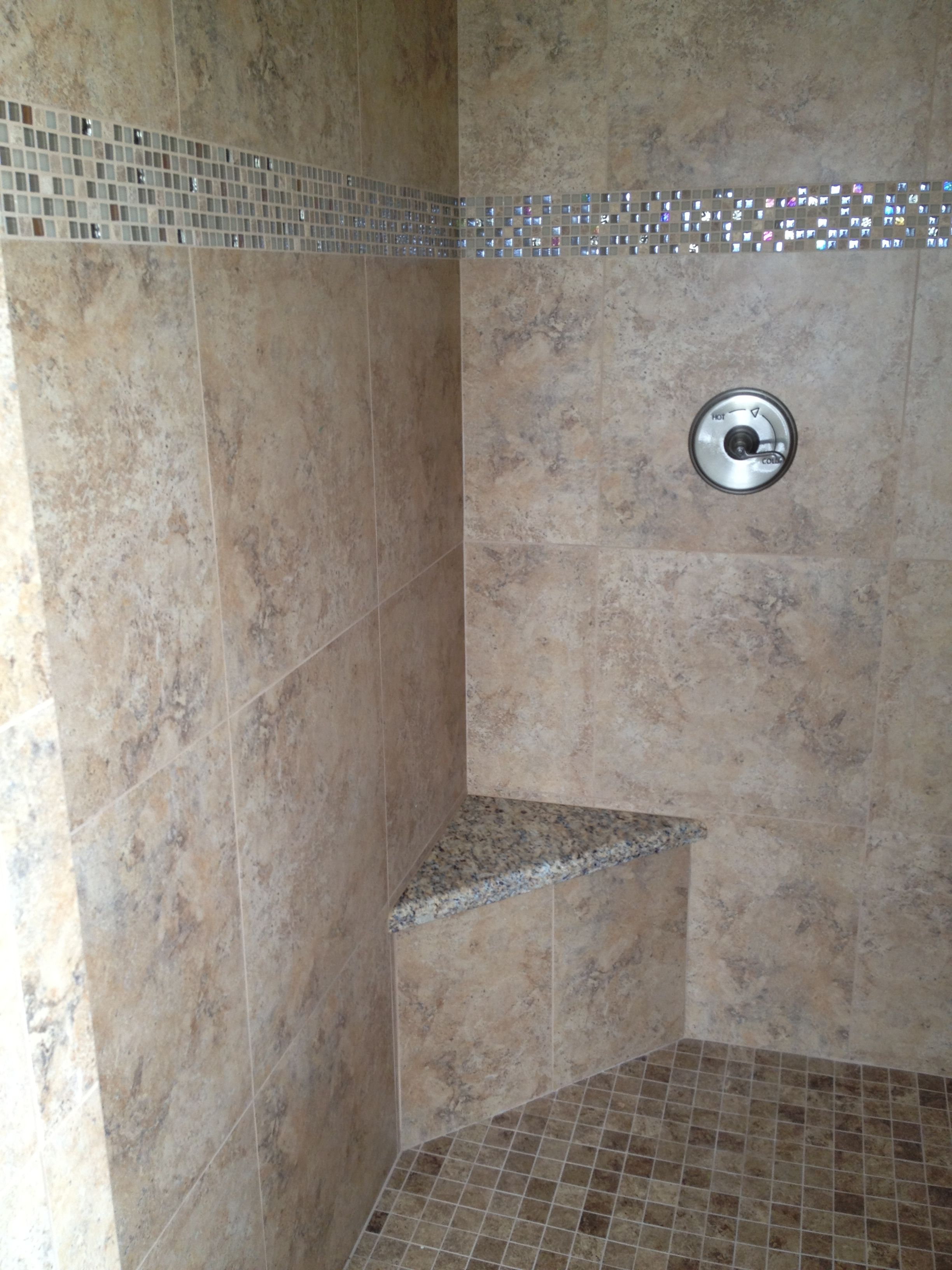 7x7 Porcelain tile installed in a master shower using Juparana