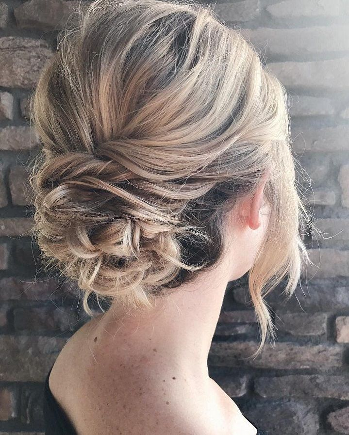 Messy textured updo bridal hairstyle
