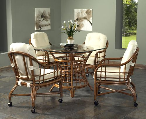 Classic Rattan is a beautiful  well crafted line of rattan and wicker  furniture for your garden room or your breakfast room. Spring Lake Caster Dining Set by Classic Rattan   Furniture Made