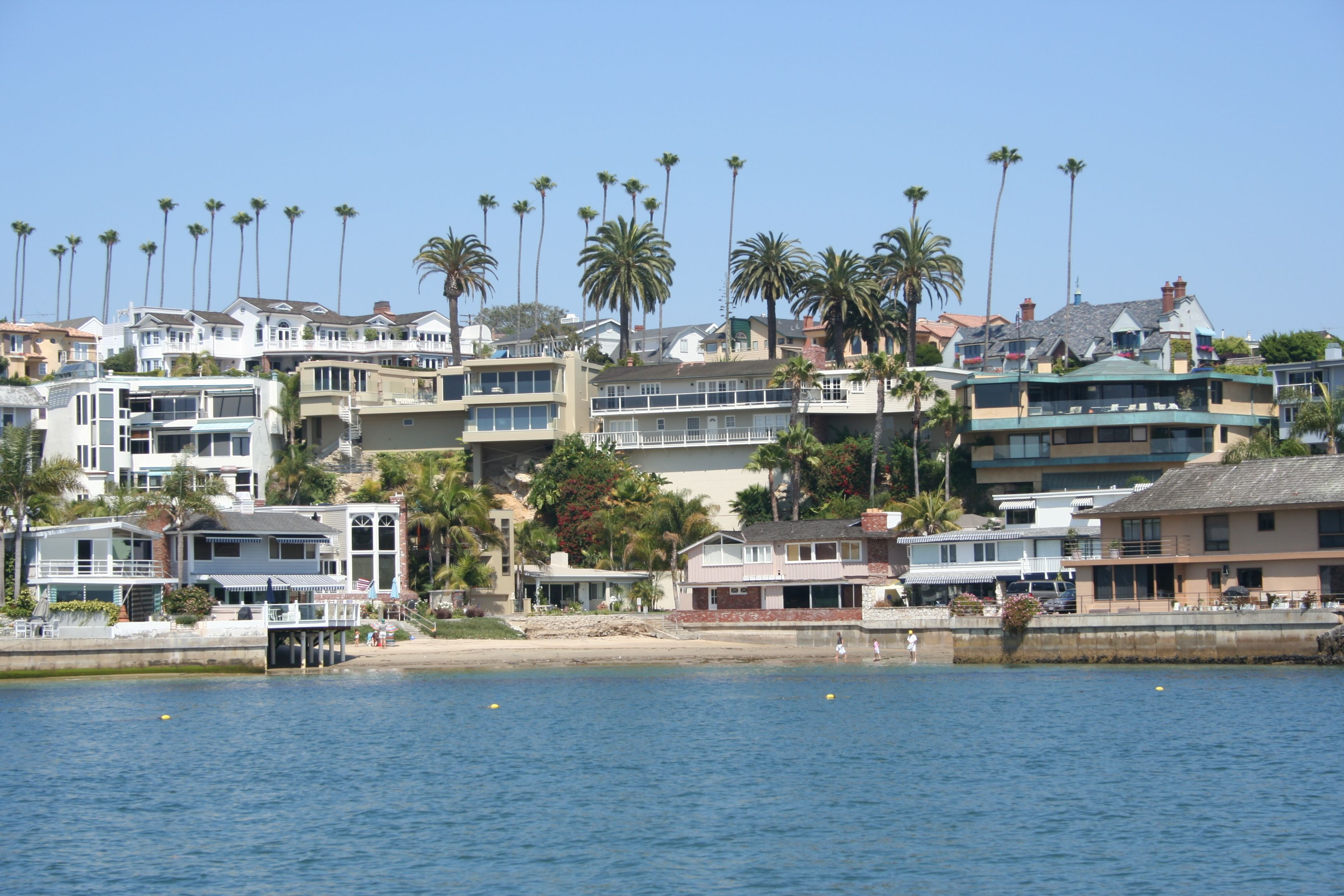 Homes on China Cove in Corona del Mar as viewed from the Main Channel of Newport Harbor.